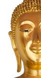 Mitad de la cara del primer de la estatua de Buda en el fondo blanco Fotos de archivo libres de regalías
