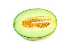 mitad de la fruta fresca del melón aislada en el fondo blanco Imagen de archivo