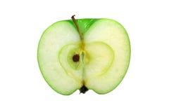 Mitad de la manzana verde Imágenes de archivo libres de regalías