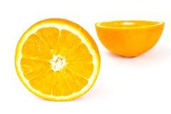 Mitad de la naranja aislada en el fondo blanco imagenes de archivo