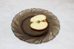 Mitad de una manzana Imagenes de archivo
