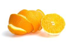 Mitad de una naranja y de algo cáscara Imágenes de archivo libres de regalías