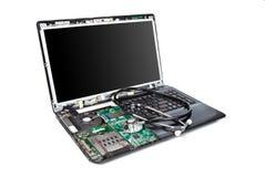Mitad del ordenador portátil desmontada con el estetoscopio en él Imagen de archivo