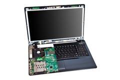 Mitad del ordenador portátil desmontada. Concepto del servicio de reparación Fotos de archivo