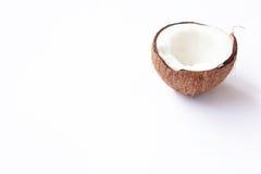 Mitad del primer del coco en un fondo blanco Fotos de archivo libres de regalías