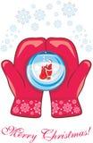Mitaines rouges avec une boule en verre photographie stock libre de droits