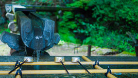 Mitarai II. In Japan, Shrine temple for worshiper wash their hands and gargle place royalty free stock photography