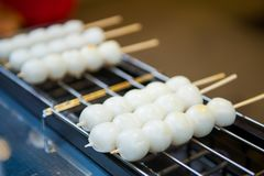Mitarashi dango ball on skewer, dongo is a local japanese cuisin. E made from flour and soy sauce Royalty Free Stock Photos