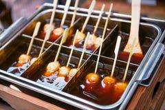Mitarashi dango ball on skewer with sauce. Food Royalty Free Stock Photos