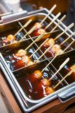 Mitarashi dango ball on skewer with sauce. Food Royalty Free Stock Photography