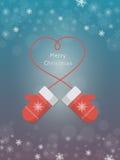 Mitenes vermelhos feitos malha no fundo do inverno Foto de Stock