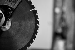 Miter Chop Saw Blade in Black and White. Miter chop saw blade close up in black and white. Power saw in a workshop royalty free stock images