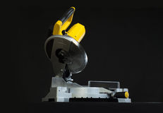 Miter saw. Compound miter power saw isolated on a black background stock image
