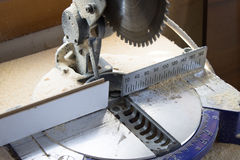 Miter saw. Machine miter saw for precise cutting of timber stock photo