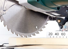Miter saw. Power chop saw cutting timber royalty free stock images