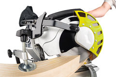 Miter saw at work. Miter saw cutting a wooden beam royalty free stock image