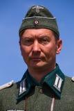 Mitglieder des roten Sterngeschichtsvereins trägt historische deutsche Uniform während der historischen Wiederinkraftsetzung von  Lizenzfreies Stockbild