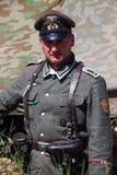 Mitglieder des roten Sterngeschichtsvereins trägt historische deutsche Uniform während der historischen Wiederinkraftsetzung von  Stockbild