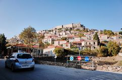 Mithymna or Molyvos. Mithymna, LESVOS - OCTOBER 10, 2014 : View of town of Molyvos or Mithymna with historic castle on hill royalty free stock photos