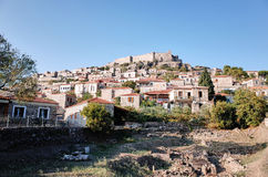 Mithymna or Molyvos. Mithymna, LESVOS - OCTOBER 10, 2014 : View of town of Molyvos or Mithymna with historic castle on hill royalty free stock image
