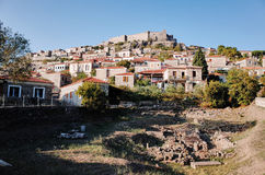 Mithymna or Molyvos. Mithymna, LESVOS - OCTOBER 10, 2014 : View of town of Molyvos or Mithymna with historic castle on hill royalty free stock images