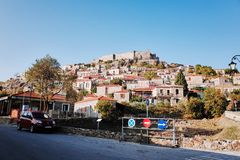Mithymna or Molyvos. Mithymna, LESVOS - OCTOBER 10, 2014 : View of town of Molyvos or Mithymna with historic castle on hill royalty free stock photography