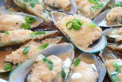 Mitilo cinese con aglio e scallion Immagini Stock