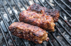 Mititei, romanian grilled meat rolls Royalty Free Stock Photography