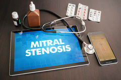 Mitral stenosis (heart disorder) diagnosis medical concept on ta. Blet screen with stethoscope royalty free stock photos