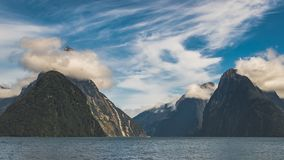 Mitre Peak hiding behind clouds royalty free stock photo