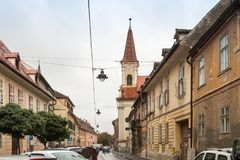 Mitropoliei street in a rainy day in Sibiu city in Romania. Sibiu, Romania, October 07, 2017 : Mitropoliei street in a rainy day in Sibiu city in Romania Stock Images