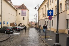 Mitropoliei street in a rainy day in Sibiu city in Romania. Sibiu, Romania, October 07, 2017 : Mitropoliei street in a rainy day in Sibiu city in Romania Stock Image