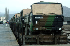 MITROVICA, KOSOVO - FEBRUARY 17, 2009: French army truck being shipped on a train, ready to leave the train station of Mitrovica Stock Photo