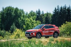 Mitsubishi Eclipse Cross in green forest Stock Images