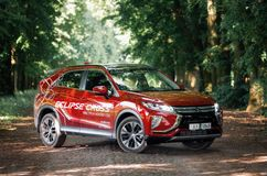 Mitsubishi Eclipse Cross in green forest Stock Photos