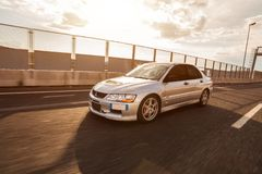 Mitsubishi EVO 8 on highway. Trieste, Italy - SEPTEMBER 3, 2013: Photo of Mitsubishi EVO 8 .The Lancer Evolution 8 sedan features a newly designed 4B11T 2.0L stock photos