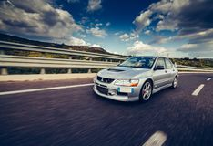 Mitsubishi EVO 8 on highway. Trieste, Italy - SEPTEMBER 3, 2013: Photo of Mitsubishi EVO 8 .The Lancer Evolution 8 sedan features a newly designed 4B11T 2.0L royalty free stock photos