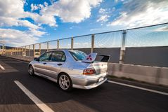 Mitsubishi EVO 8 on highway. Trieste, Italy - SEPTEMBER 3, 2013: Photo of Mitsubishi EVO 8 .The Lancer Evolution 8 sedan features a newly designed 4B11T 2.0L stock photo
