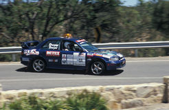 Mitsubishi Evo Sideways. The Mitsubishi Lancer Evo pace car going slightly sideways on the approach to the Windy Point hairpin on the 2007 Classic Adelaide royalty free stock photography