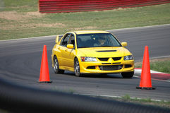 Mitsubishi Evolution Sedan driving on Race Course. A Mitsubishi Evolution sedan sports car driving on a race course. See my portfolio for more automotive images royalty free stock photography