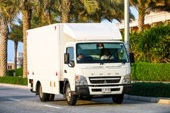 Mitsubishi Fuso Canter. Dubai, UAE - November 18, 2018: Cargo van Mitsubishi Fuso Canter in the city street stock photography
