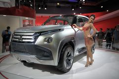 Mitsubishi GC-PHEV Concept. Girl near SUV Mitsubishi GC-PHEV Concept at the Moscow International Automobile Salon in Moscow Royalty Free Stock Image