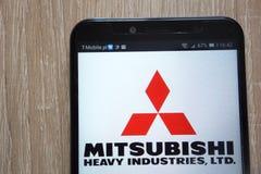 Mitsubishi Heavy Industries logo wystawiający na nowożytnym smartphone zdjęcie royalty free