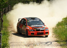 Mitsubishi Lancer Evo IX rally car. Daniele Ceccoli of  Italy with Marco Mirabella (co-pilote)    drives his Mitsubishi Lancer Evo IX  during the third stage of Royalty Free Stock Photography