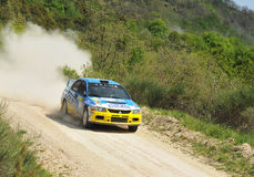 Mitsubishi Lancer Evo IX  rally car. Simone Campedelli of  Italy with Danilo Fappani  (co-pilote)    drives his Mitsubishi Lancer Evo IX  during the sixth stage Royalty Free Stock Photos