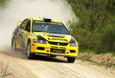 Mitsubishi Lancer Evo IX  rally car. Loris Baldacci of  San Marino Republic  with  Alessandro Biordi (co-pilote)   drives his Mitsubishi Lancer Evo IX  during Royalty Free Stock Photo