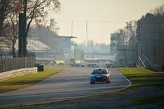 Mitsubishi Lancer Evo IX samlar bilen på Monza Royaltyfri Bild