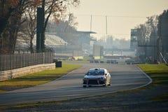 Mitsubishi Lancer Evo X samlar bilen på Monza Royaltyfria Foton