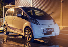 Mitsubishi MiEV parked on the street at night. Mitsubishi innovative Electric Vehicle. Royalty Free Stock Photography
