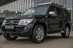 Mitsubishi Pajero. At the ALT 2013 exhibition in Vilnius,Lithuania on May 10-12th, 2013. Outdoors, modern building background Royalty Free Stock Photo